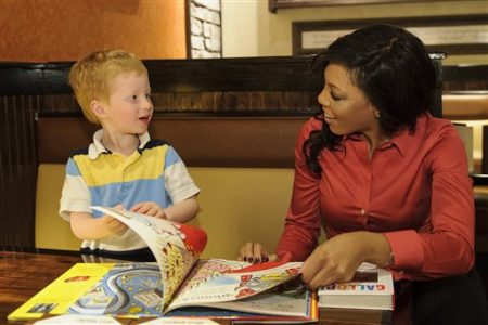 "IMAGE DISTRIBUTED FOR LONGHORN STEAKHOUSE - Jackson reads with Atlanta-area LongHorn Steakhouse Managing Partner Lisa Hoggs in honor of International Children's Book Day on Wednesday, Apr. 2, 2013. Today only, LongHorn is offering a ""Give a Book, Get a Free Steakhouse Kid's Meal"" promotion, benefiting local Boys & Girls Clubs across the country. With each children's book donation, guests will receive a free kid's meal with the purchase of one adult entrée. (Paul Abell / AP Images for LongHorn Steakhouse)"